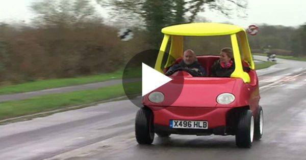 Two Adults Are Driving In A Little Tykes Car. A Closer Look Reveals Something STUNNING..WHOA!