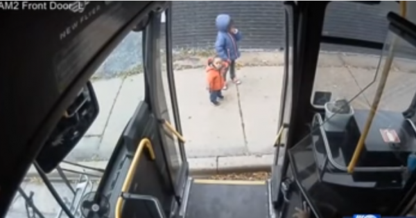 Bus driver notices two frightened kids walking on the sidewalk, immediately knows something is wrong