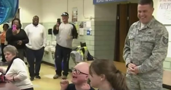 Boy with down syndrome has no clue his military dad is home, then someone gives him a tap..