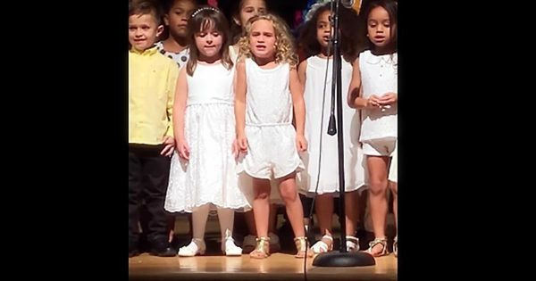 Preschoolers line up for a performance, but audience can't believe the blonde girl in the middle