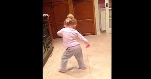Little girl breaks it down and dances to her favorite song while her family absolutely loses it