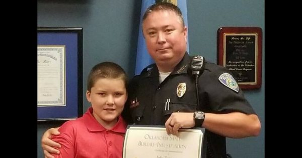 Cop finds abused 8-year-old, wrists bound with belt. Takes him to ER and never leaves his side