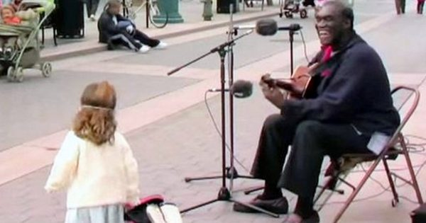 Street performer is singing a classic song, but when someone else joins him, the entire crowd is all smiles