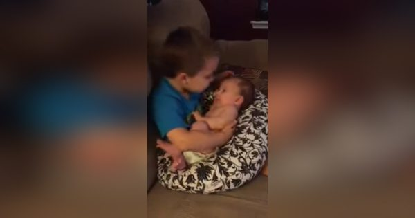 Mom Sneaks on Son Holding his Baby Sister, What she Records him Uttering is Going Viral