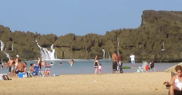It Looks Like A Normal Day At The Beach, But at 0:33 Something Spectacular Happens