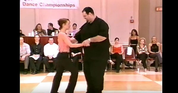 Big Man Takes Her Hand to Dance – His Next Move Has The Entire Crowd On Their Feet Cheering
