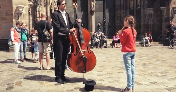 Little Girl Walks Up to Street Musician and Plays Flute For Him – Moments Later, The Entire Crowd is In Awe
