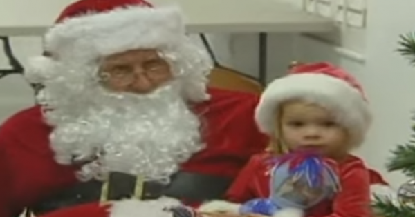 Tiny Girl Sits On Santa's Lap and Asks for a Special Gift – Then He Asks Her to Turn Around