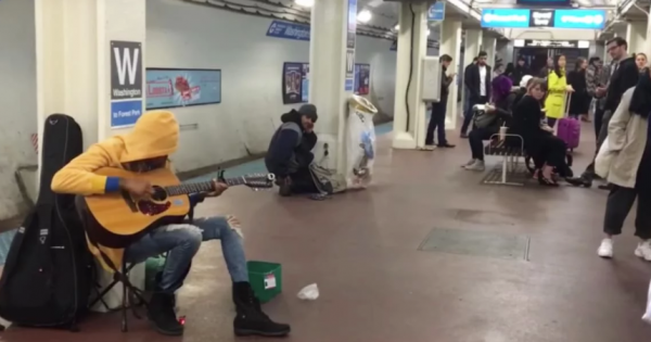 Subway performer begins to play guitar. Seconds later, commuters freeze in their tracks at her 1st note