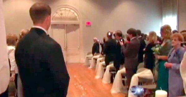 "Groom Anxiously Waits For Doors to Open, Breaks Down in Tears When Paralyzed Bride ""Walks"" Through"