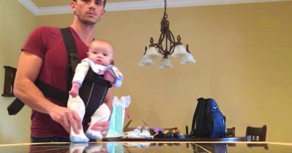 "Hunky Dad Is Home Alone With Baby – Hits Record And Films ""Dance"" Routine That Has Millions Smiling"