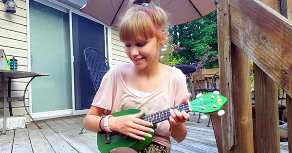 Young Girl Strums Ukulele, But It's The Moment She Starts Singing Elvis Classic That's Gone Viral