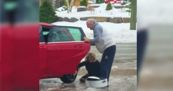 Woman Struggles To Get In Car On Icy Driveway, But It's Mom's Uncontrollable Laugh That Steals The Show