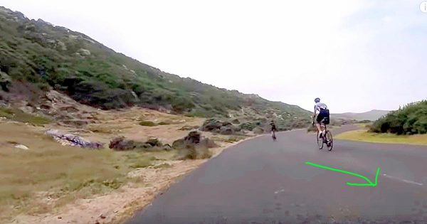 Cyclists Ride Down Rural Road, Out Of Nowhere Unexpected Runner Starts Hilarious Race With Them