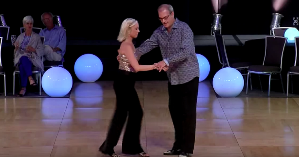 Older Man And Young Woman Step Onto The Dance Floor — Their Slick Footwork Makes Crowd Go Wild