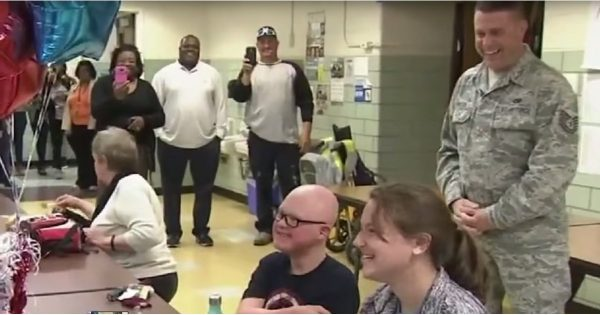 Boy with down syndrome has no idea military dad is home, Then he feels a tap..