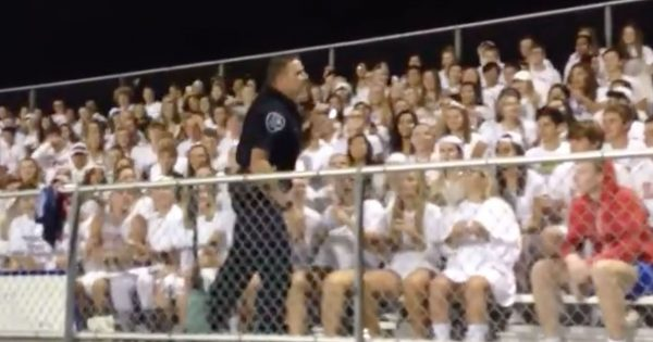 School officer Interrupts students cheering during football game — his next move has entire crowd in uproar