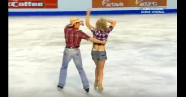 Country couple strike pose on ice. Their bold next move has entire audience on their feet
