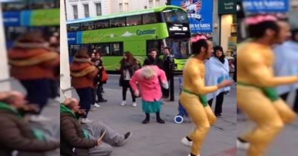 Street Dancer Gets People's Attention, But It's The Little Old Lady In Pink Coat Who Steals The Spotlight