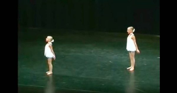 2 sisters take position onstage. Seconds later their mesmerizing routine makes the audience lose their breath