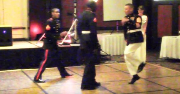 Marine is challenged to a dance off. Within seconds, he has entire room on their feet cheering