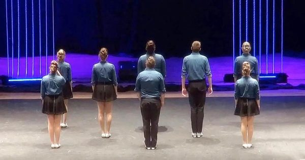 8 dancers turn their back to the audience – when they turn around, everyone goes crazy