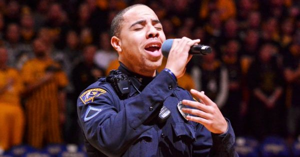 Singer failed to show up for game, then local cop put crowd on silence with chilling national anthem performance