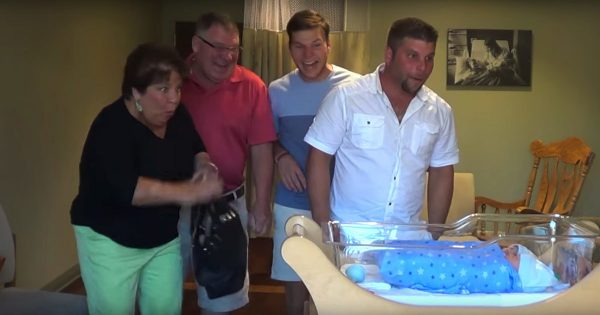 Family rush into hospital room to meet newborn – but they have no idea what's waiting for them in the crib