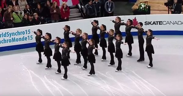 16 skaters stand frozen in cube formation. Seconds later the crowd goes crazy when they perform daring routine