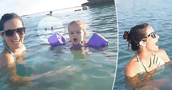 Mom and kids were swimming happily. But then 'something' emerges from underwater that has them all screaming