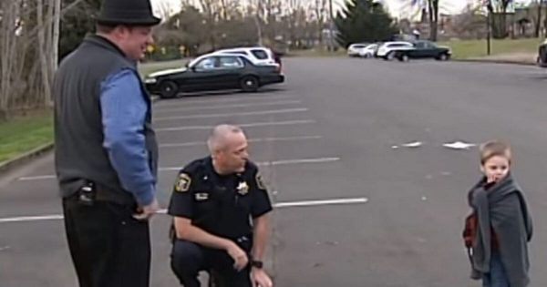 Cop looks in suspicious car in empty parking, discovers shivering kid inside and knows he needs to act fast