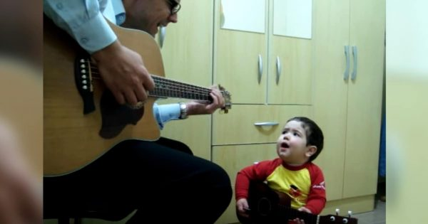 Dad plays Beatles classic on guitar, then 1-year-old son takes over and steals the show