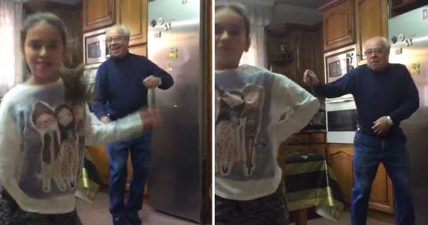 Girl records her dance routine in kitchen, Now watch when her grandpa shows up in the back
