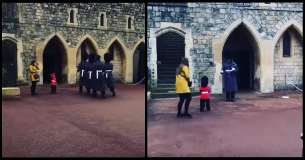 Toddler dressed as Queen's Guard salutes soldiers. Then one of them breaks formation and does the unexpected