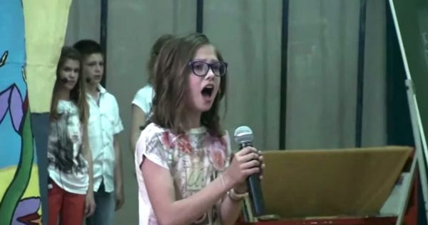 Timid little girl steps up to mic. Within seconds, entire school is blown away with her flawless voice