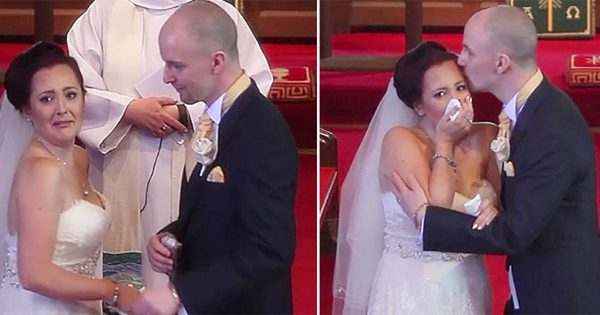Groom interrupts vows and tells bride to turn around. She sees singers' faces and loses it