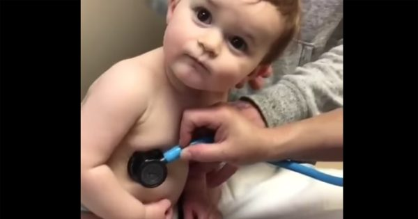 Nurse gently checks baby's heartbeat, only to have him surprise her with move that's going viral