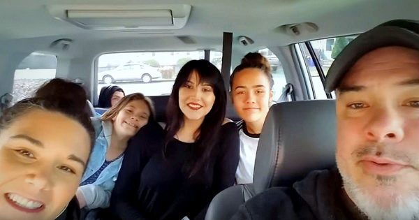 Dad holds phone up to take selfie. Family screams when someone emerges from the backseat