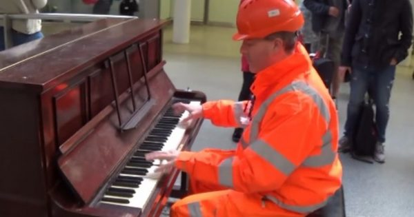 Workman walks humbly up to train station piano – commuters freeze in their tracks as fingers fly across keys