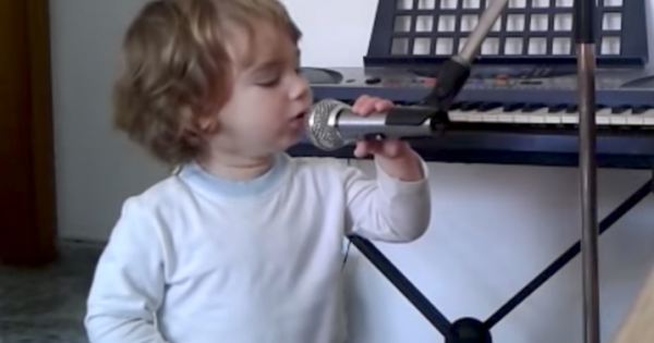 Dad starts playing guitar – now watch when toddler steps up to mic and steals the show