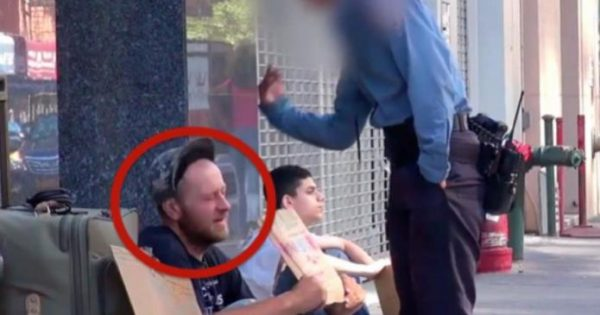 Police officer is filmed beating a homeless man – but keep an eye on the kid on the right