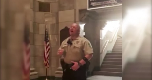 Cop standing in empty courthouse suddenly breaks into song – and his chilling voice will give you goosebumps