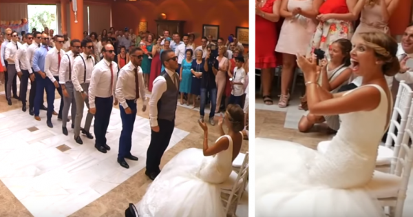 Groomsmen stand up in line in front of bride but when young brother walks in, he steals the show