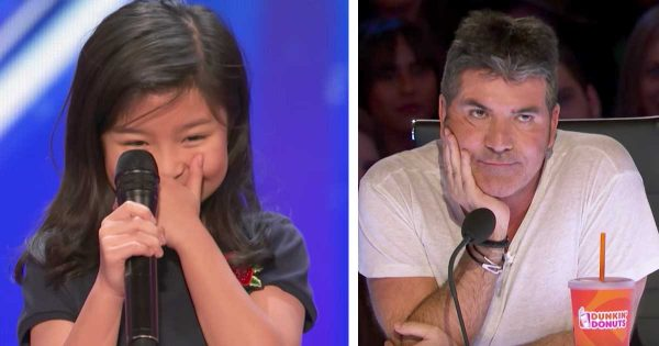 Simon rolls his eyes when little girl says she's next Celine Dion. Seconds into performance, her voice forces him to his feet