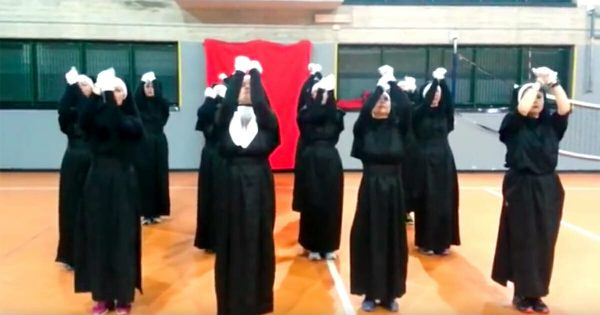 12 nuns stand in formation and raise their arms up – then the music starts and I can't stop laughing