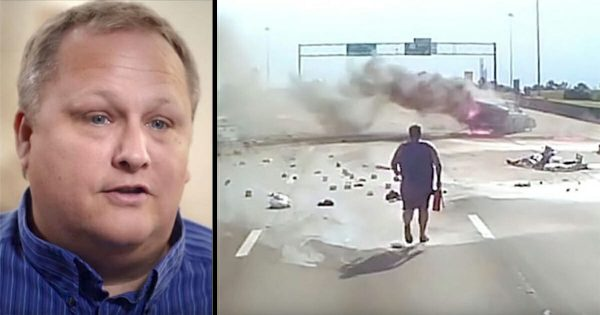 Trucker jumps out and runs towards fiery highway crash – dash cam catches moment he opens the car's door