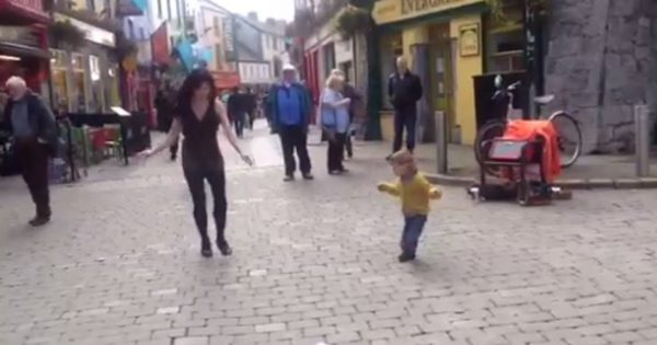 Adorable 2-year-old toddler sees a woman Irish dancing in the streets and decides to join in