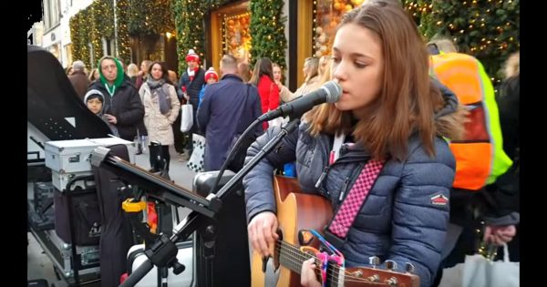 Young girl instantly earns thousands of fans after belting out Elvis Presley classic on busy street