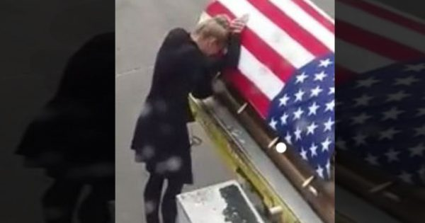 Woman puts hand on flag-draped casket. Passengers left sobbing as they realize what's happening