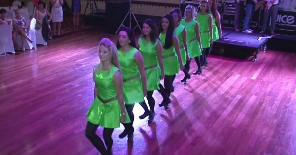 8 bridesmaids storm the floor to perform an Irish dance – watch now when the groom steps in